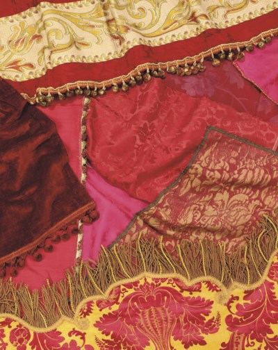 A COLLECTION OF RED SILK DAMAS