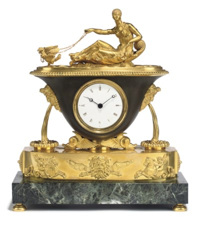 A REGENCY ORMOLU AND PATINATED