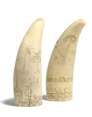 A PAIR OF SCRIMSHAW WHALES TEE