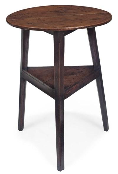 A GEORGE III OAK CRICKET TABLE