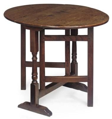 A GEORGE II OAK GATELEG TABLE