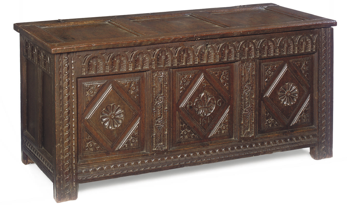 A JAMES I OAK PANELLED CHEST