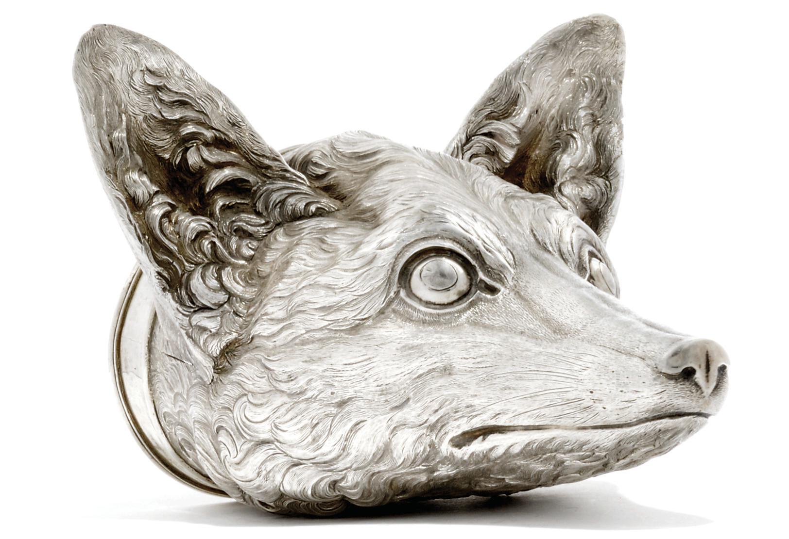A GEORGE IV SILVER STIRRUP CUP MODELLED AS A FOX'S HEAD