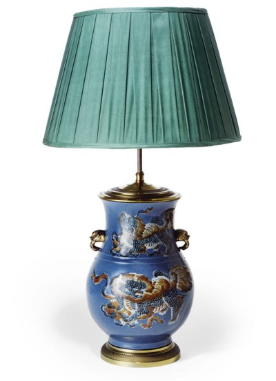 A CHINESE SLIP-DECORATED LAMPE
