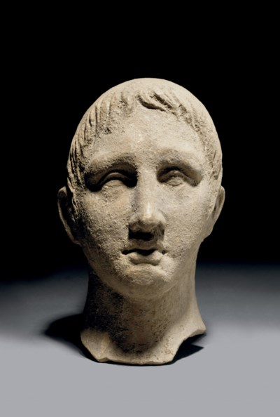 AN ETRUSCAN TERRACOTTA HEAD OF