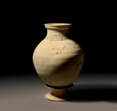 A SYRIAN POTTERY JAR WITH INCI