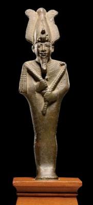 AN EGYPTIAN BRONZE FIGURE OF O