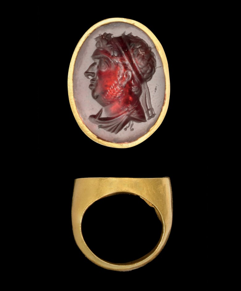A Hellenistic gold and garnet intaglio ring with royal portrait of a Ptolemaic ruler, probably Ptolemy IX, Soter II, Late 2ndearly 1st century BC. Bezel 1  in (2.6 cm) long, ¾ in (1.9 cm) wide. Sold for £51,650 on 27 October 2009 at Christie's in London, South Kensington