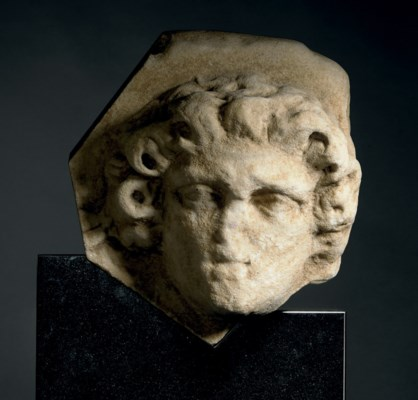 A ROMAN MARBLE RELIEF HEAD