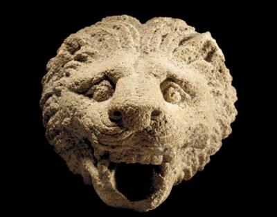 A GREEK LIMESTONE LION HEAD SP