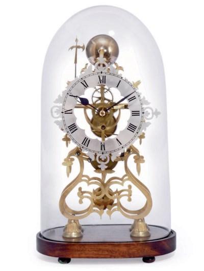 A VICTORIAN BRASS TIMEPIECE SK