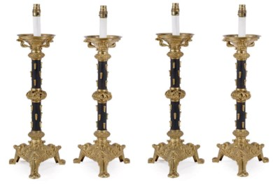 A SET OF FOUR GILT AND PATINAT
