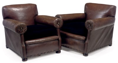 A PAIR OF FRENCH LEATHER ARMCH