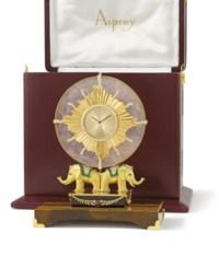 "Asprey. An unusual and decorative 18K gold and gem-set ""elephant"" table clock with original box"