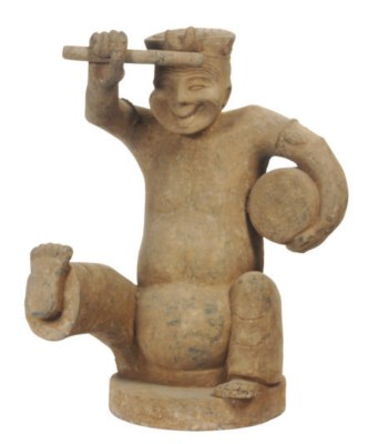 A HAN STYLE POTTERY FIGURE OF