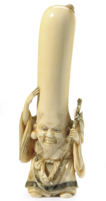 A JAPANESE IVORY CARVED FIGURE