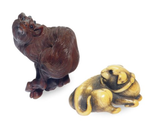 A JAPANESE CARVED IVORY DOG-FO