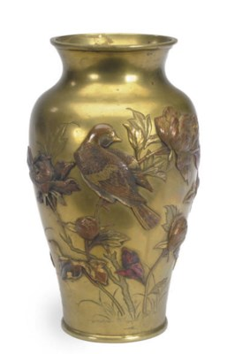 A BRONZE AND MIXED METAL VASE