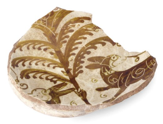 A FATIMID LUSTER POTTERY FRAGM