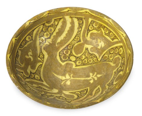 A NISHAPUR POTTERY BOWL PAINTE