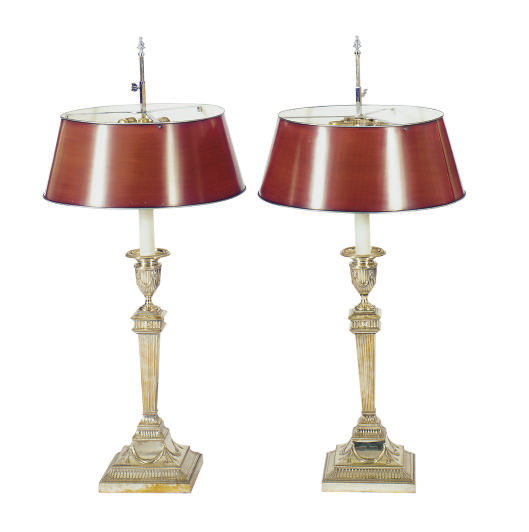 A PAIR OF SILVERED-METAL COLUM