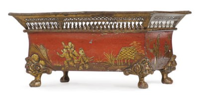 A RED AND GILT-DECORATED TOLE