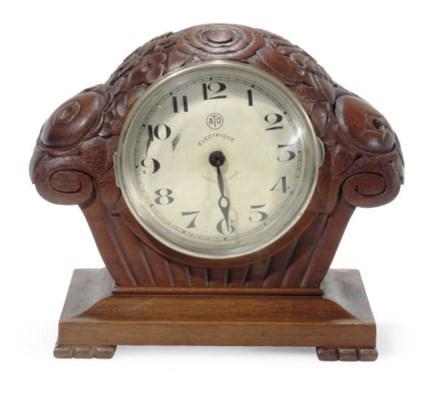 A FRENCH WALNUT MANTLE CLOCK,