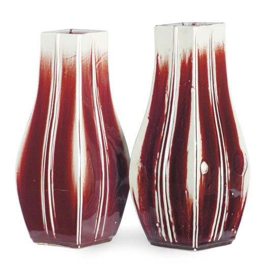 A PAIR OF CERAMIC OX-BLOOD RED