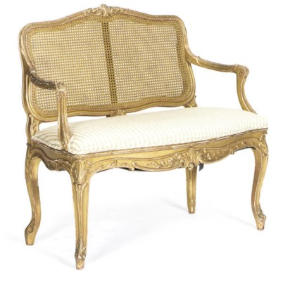 A GILTWOOD AND CANED SERPENTIN