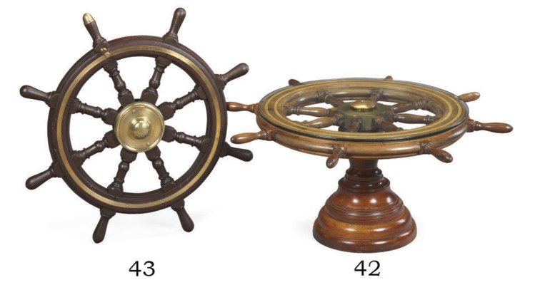 An eight spoked wood and brass