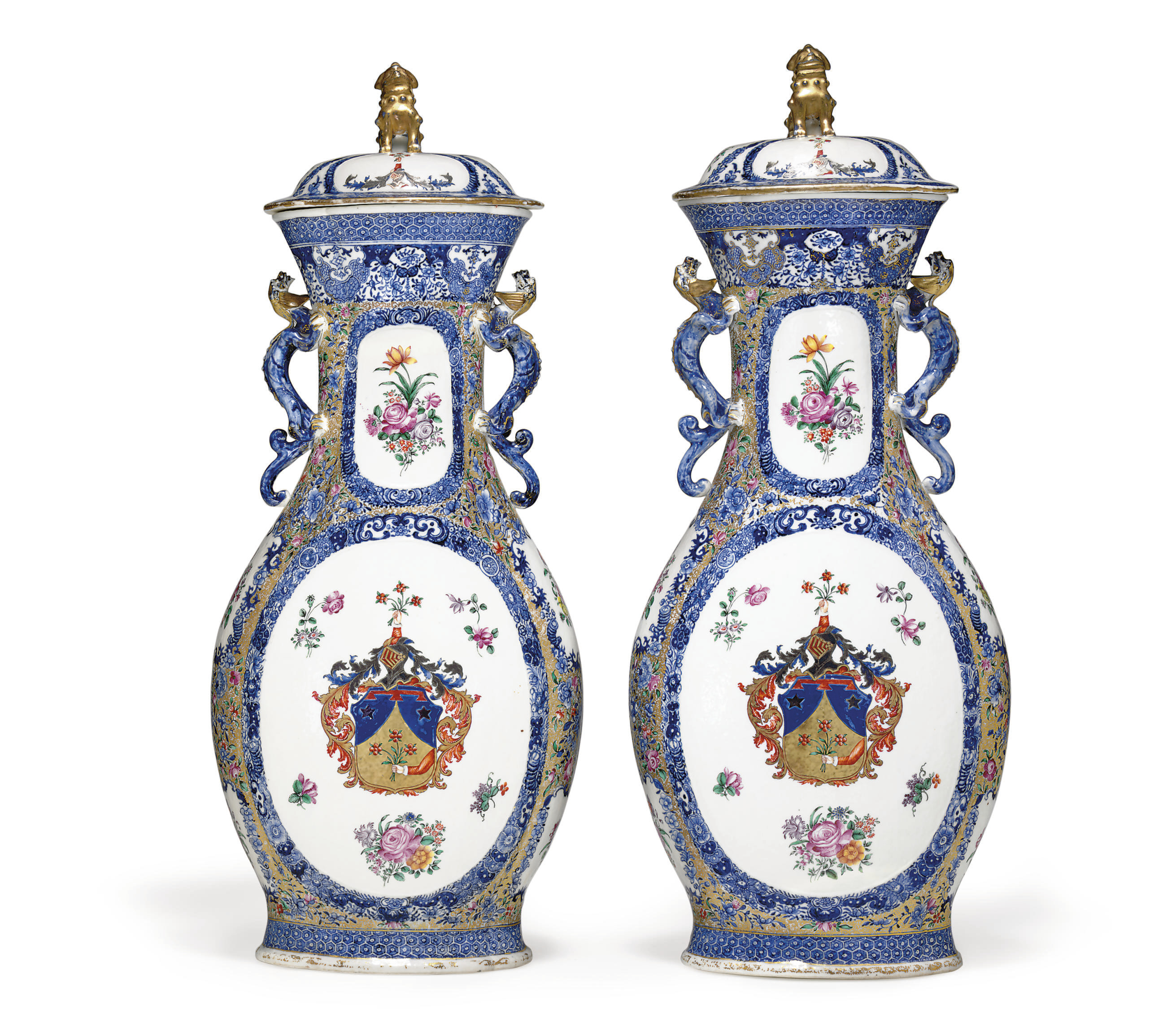 A VERY LARGE PAIR OF ARMORIAL VASES AND COVERS