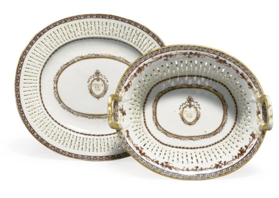 A SEPIA AND GILT BASKET AND ST