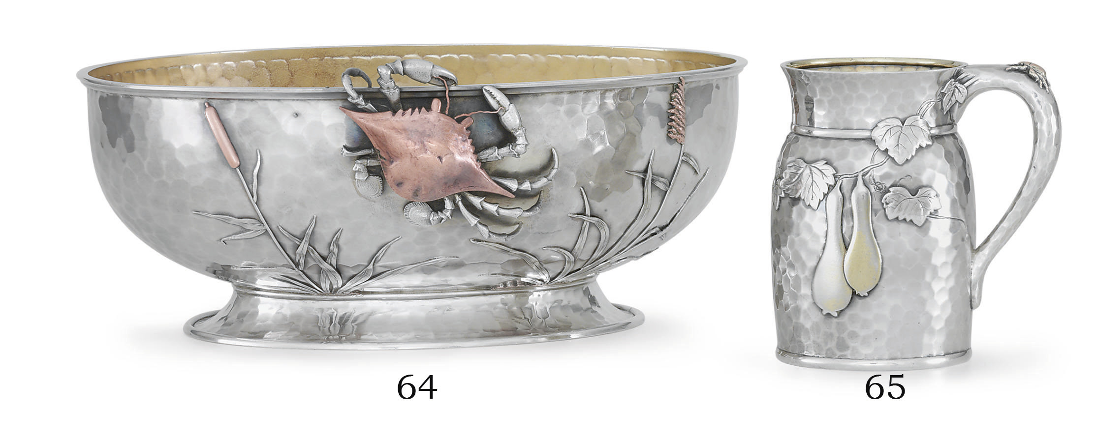 A SILVER AND MIXED-METAL CENTERPIECE BOWL