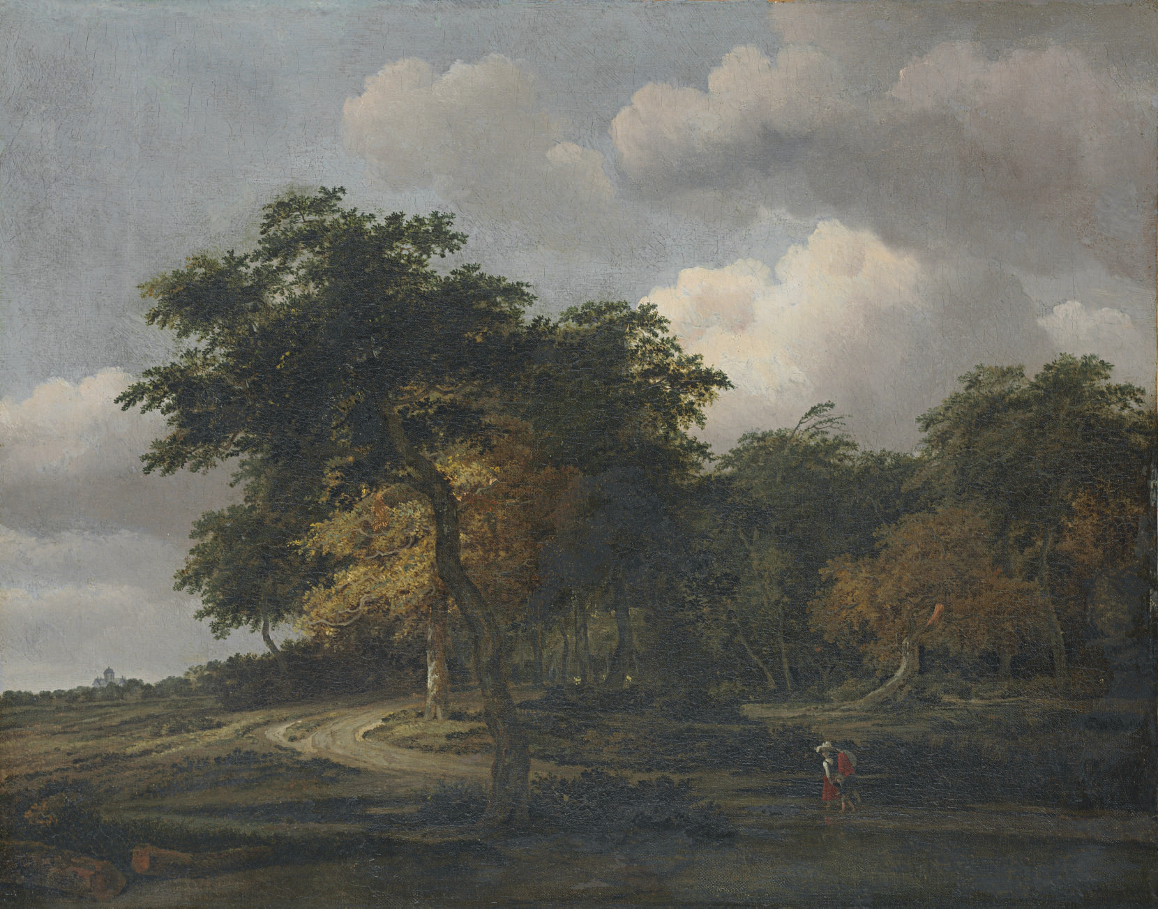 A wooded landscape with a distant view of the Huis Ten Bosch