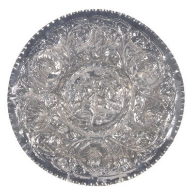 A SILVER DISH WITH REPOUSSE CO