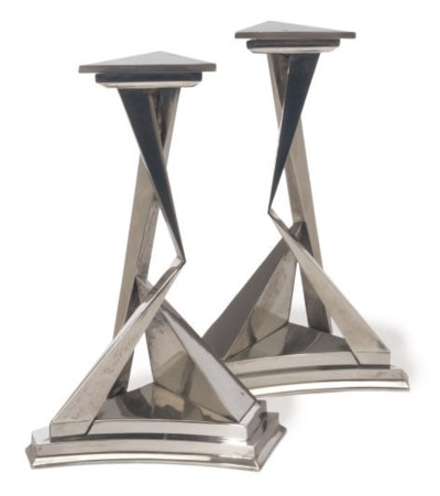 A PAIR OF SILVERED-METAL 'L'IM