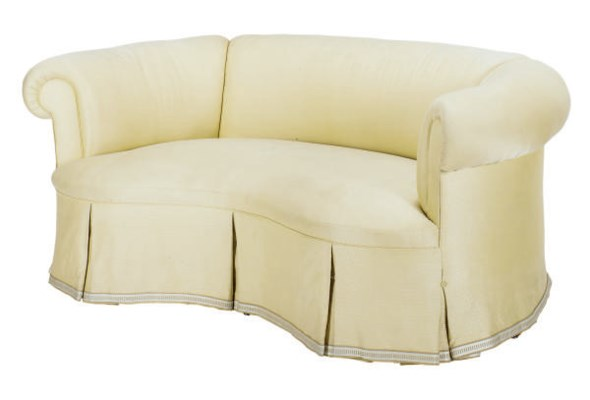 A CREAM-UPHOLSTERED CURVED SOF