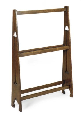 AN OAK CLOTHING RACK,