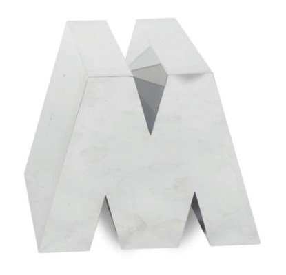 A CHROMED METAL 'M' FORM SIDE