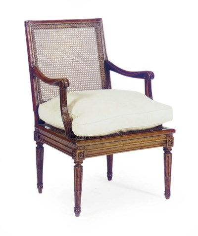 A LOUIS XVI WALNUT AND CANED F