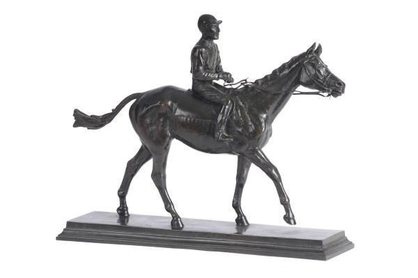A BRONZE JOCKEY ON HORSE,