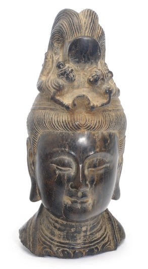 AN ASIAN CARVED STONE HEAD,