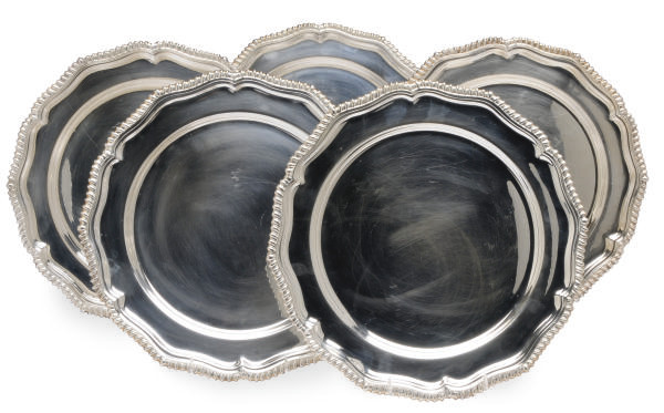 AN ENGLISH SET OF FORTY-FOUR SILVER-PLATED SERVICE PLATES,