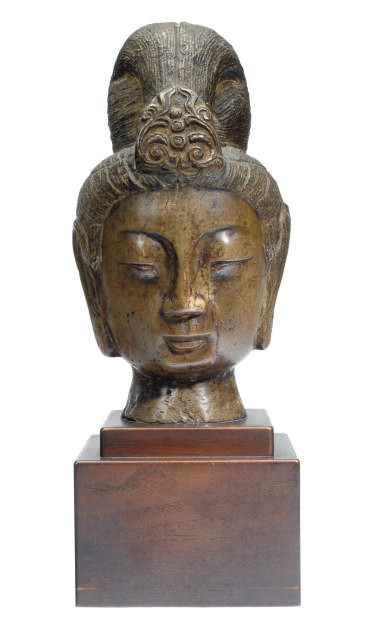 A TANG-STYLE CARVED STONE HEAD