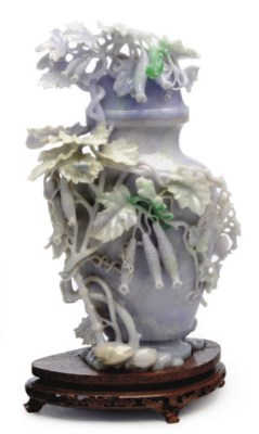 A CHINESE CARVED PALE LAVENDER