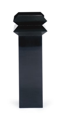 AN EBONIZED SIDE TABLE AND PED
