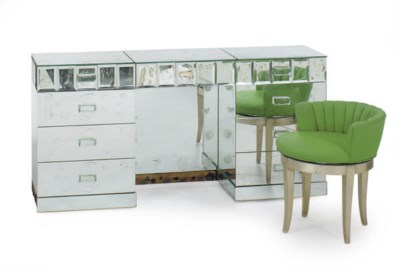 A MIRRORED DRESSING TABLE,