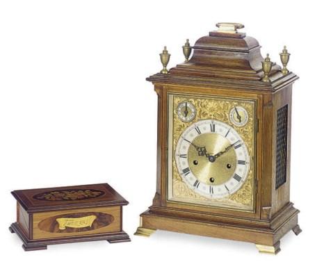 A GERMAN WALNUT MANTEL CLOCK,