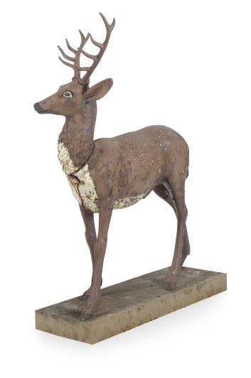 A PAINTED CAST IRON FIGURE OF