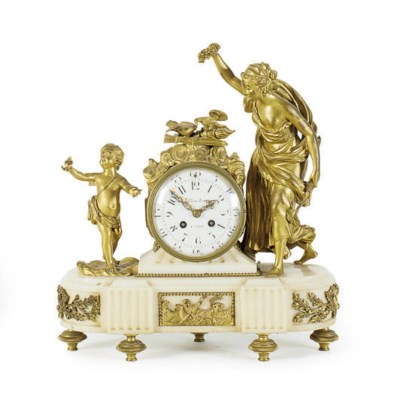 A FRENCH ORMOLU AND MARBLE FIG